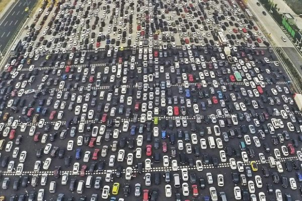 Vehicles are seen stuck in a traffic jam near a toll station as people return home at the end of a week-long national day holiday, in Beijing, China, October 6, 2015. Picture taken October 6, 2015. REUTERS/China Daily CHINA OUT. NO COMMERCIAL OR EDITORIAL SALES IN CHINA     - RTS3HL4